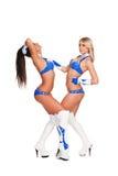 Tweepartijen meisjes in stadiumkostuums Stock Foto