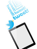 Tweet. A bird tweeting on a pc tablet Stock Photography
