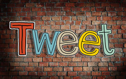 Tweet Concepts and Brick Wall in the Background Stock Images