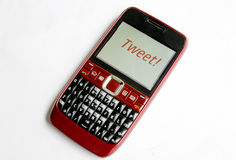 Tweet  on a mobile phone Royalty Free Stock Image