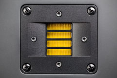 Tweeter loudspeaker. Yellow tweeter - high-frequency loudspeaker, closeup Stock Photography