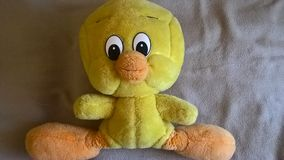 Tweety on bed Royalty Free Stock Image
