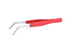 Tweezers. With a comfortable, non-slip coating, covered with red plastic isolated on white background Stock Photos