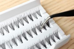 Tweezers with false eyelash. Closeup royalty free stock photos
