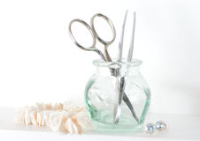 Tweezers and scissors for grooming Stock Photos