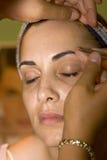 Tweezing eyebrow royalty free stock image