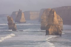 The Twelve Apostles along the Great Ocean Road, Victoria, Australia. Photographed at sunrise. Dawn fog stock photos