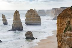 Misty coastline with stacks in the ocean, Twelve Apostles, Australia, evening light at rock formation Twelve Apostles Stock Photos