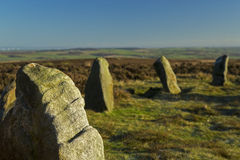 Twelve apostles stone circle ilkley moor. A close up view of part of the twelve apostles stone circle on Ilkley Moor, in West Yorkshire, England. In the royalty free stock image
