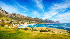 The Twelve Apostles, which are on the ocean side of Table Mountain at Cape Town South Africa. And the beach community of Camps Bay between the mountain and the Royalty Free Stock Photo