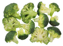 Twelve branches of fresh  broccoli. Twelve pieces of fresh green broccoli cabbage  lie on a table of the cook. Isolated top view image Royalty Free Stock Images