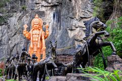 Horse chariot in Kuala Lumpur. Twelve bronze horses pull Vishnu`s chariot and stand at the entrance to the Ramayana Cave at the Batu Cave Complex in Kuala royalty free stock images
