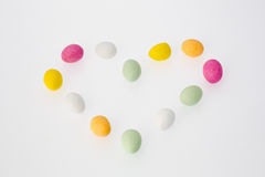 Colorful Chocolate Eggs in Heart-shape Stock Images