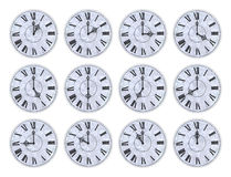 Twelve clock faces Royalty Free Stock Image