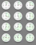 Twelve clocks showing different time. Vector Royalty Free Stock Photography