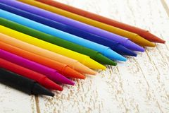 Twelve color pastel crayon  in box close up with woody texture backgrou. Nd Stock Photo