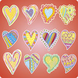 Twelve colored hearts Stock Photography
