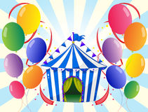 Twelve colorful balloons and the stripe tent Royalty Free Stock Image