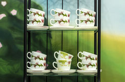Twelve cups on the two shelf Royalty Free Stock Images