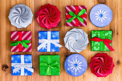 Twelve cute little Christmas gift boxes Stock Photography