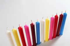 Twelve cylindrical colored candles Stock Images