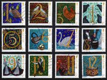 Twelve days of Christmas on postage stamps. Twelve postage stamps from isle of Man, with images of Twelve days of Christmas Royalty Free Stock Images
