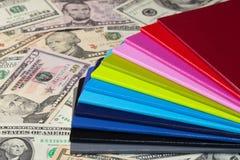Twelve diaries and U.S. dollars Stock Photos