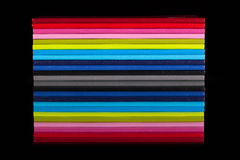 Twelve different color diaries on a black glass table Royalty Free Stock Image