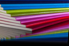 Twelve different colors diaries Stock Images
