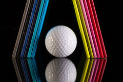 Twelve different colors diaries and golf ball Stock Image