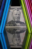 Twelve different colors diaries and US dollar Royalty Free Stock Photo