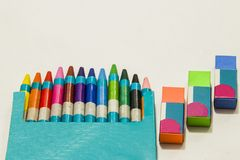Colour crayons on white background. Twelve different Colour crayons and three erasers on white background Royalty Free Stock Photo