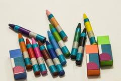 Colour crayons on white background. Twelve different Colour crayons and three erasers on white background Stock Photos