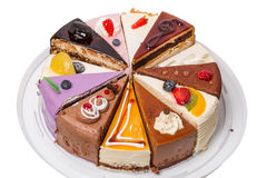 Twelve different pieces of cake on white Royalty Free Stock Image