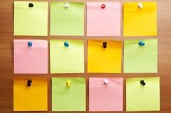 Twelve empty  post it. Twelve empty post it on wooden wall Stock Photos