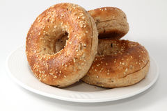 Twelve Grain Bagels. Twlve grain bagels on a white plate Royalty Free Stock Images