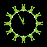 Twelve green bunnies with white tails as wall clocks Stock Photos