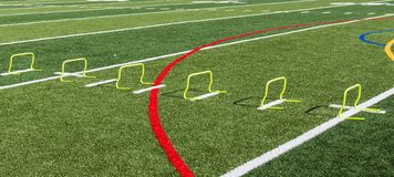 12 inch yellow mini hurdles on a turf field stock images