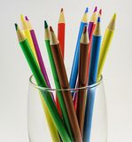 Colored pencils in a transparent glass royalty free stock photos