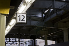 Twelve number label on the train station. Royalty Free Stock Photo