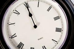 Twelve O'Clock. Circular clock with Roman numerals showing twelve o'clock (12:00 stock photography