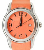 Twelve o'clock on dial of orange wristwatch Stock Images