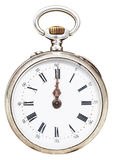 Twelve o'clock on the dial of retro pocket watch Stock Image