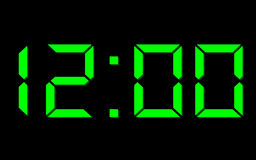 Twelve o'clock. Green numbers on digital clock Stock Photo
