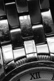 Twelve O`Clock. Macro of watch strap and dial showing number twelve in roman numerals Royalty Free Stock Photos