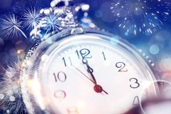 Twelve o`clock - new year`s eve. New Year`s at midnight - Old clock with stars snowflakes and holiday lights Stock Photography