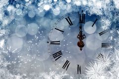 Twelve o`clock - new year`s eve. New Year`s at midnight - Old clock with stars snowflakes and holiday lights Stock Photos