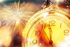 Twelve o`clock - new year`s eve. New Year`s at midnight - Old clock with stars snowflakes and holiday lights Royalty Free Stock Photography
