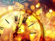 Twelve o`clock - new year`s eve. New Year`s at midnight - Old clock with stars snowflakes and holiday lights Stock Images