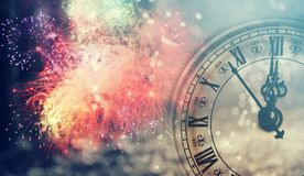 Twelve o`clock - new year`s eve. New Year`s at midnight - Old clock with stars snowflakes and holiday lights Royalty Free Stock Images